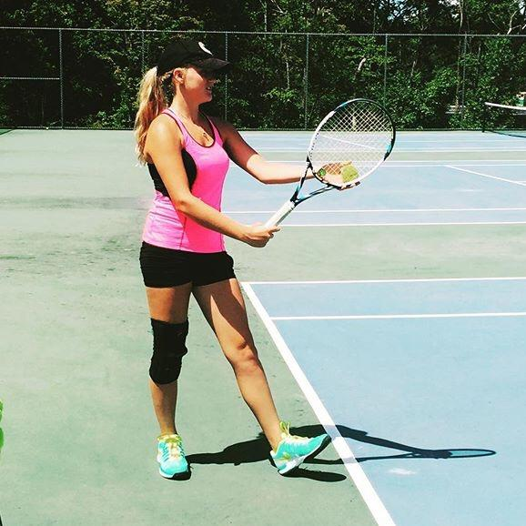 Abby Caddick prepares to serve during a practice tennis match